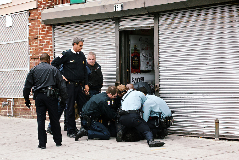 DC police commander Andy Solberg monitors as officers arrest an a man allegedly trying to rob a liquor store.