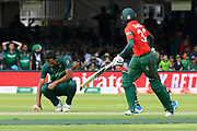 Wahab Riaz of Pakistan slumps to the ground as Mohammad Mahmudullah Riyad of Bangladesh is dropped during the ICC Cricket World Cup 2019 match between Pakistan and Bangladesh at Lord's Cricket Ground, St John's Wood, United Kingdom on 5 July 2019.
