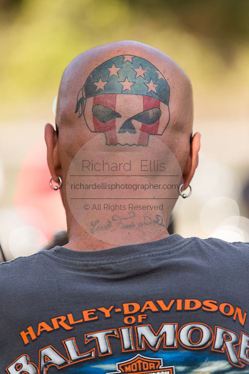 A biker sports a skull tattoo on his head during the 74th Annual Daytona Bike Week March 8, 2015 in Daytona Beach, Florida. More than 500,000 bikers and spectators gather for the week long event, the largest motorcycle rally in America.
