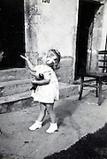 little girl playing outside France vintage
