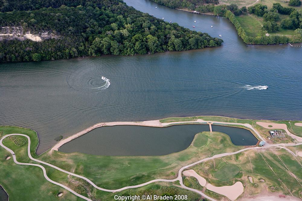 The Colorado River flows toward Austin, Texas as Lake Austin past the Austin Country Club.