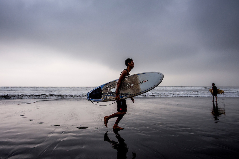A surfer exits the water at Shonan Beach in Fujisawa, Kanagawa Prefecture, 50 kilometers south of Tokyo, ahead of Typhoon Neoguri. The typhoon is one of the strongest to hit the country in more than a decade, and has already caused damage, injuries, and at least one death in the southern islands of Japan. The storm is expected to weaken as it churns its way north and east across the archipelago, but authorities are warning of flooding and landslides caused by massive amounts of rain.