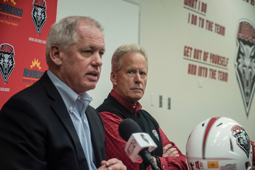 UNM's Paul Krebs(Cq),left, and head coach Bob Davie(cq), announced Friday afternoon that the department will be slashing season tickets by 10% for the upcoming season. <br />  Albuquerque New Mexico(Roberto E. Rosales/Albuquerque Journal)