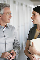 Business man and female colleague talking in office