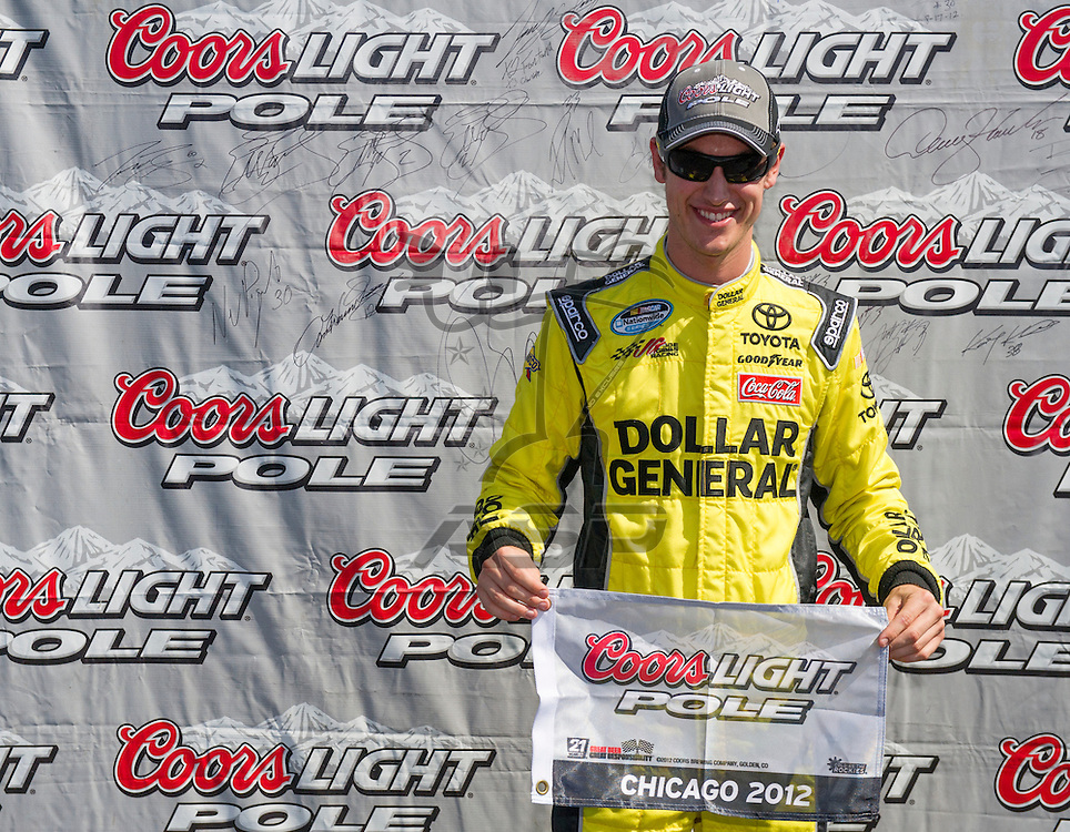 Joliet, IL - SEP 15, 2012:  Joey Logano (18) accepts the Coors Light Pole Award for The Dollar General 300 at Chicagoland Speedway in Joliet, IL.
