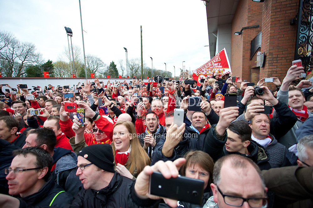 LIVERPOOL, ENGLAND - Sunday, April 13, 2014: Liverpool supporters welcome the team coach before the Premiership match against Manchester City at Anfield. (Pic by David Rawcliffe/Propaganda)