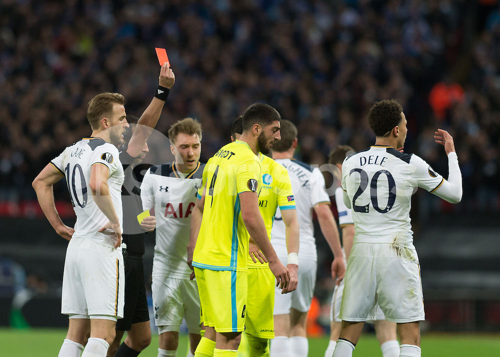 Dele Alli of Tottenham Hotspur is shown the red card during the UEFA Europa League  Round of 32 Game 2 match between Tottenham Hotspur and Gent at Wembley Stadium, London, England on 23 February 2017. Photo by Vince  Mignott.