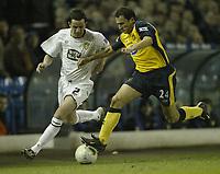 Photo: Aidan Ellis.<br /> Leeds United v Wigan Athletic. The FA Cup. 17/01/2006.<br /> Leeds Gary Kelly battles with Wigan's Skoko