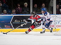 KELOWNA, CANADA - NOVEMBER 23:  JT Barnett #17 of the Kelowna Rockets skates with the puck while being checked by Ty McLean #13 of the Regina Pats at the Kelowna Rockets on November 23, 2012 at Prospera Place in Kelowna, British Columbia, Canada (Photo by Marissa Baecker/Shoot the Breeze) *** Local Caption *** JT Barnett;Ty McLean;
