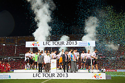 BANGKOK, THAILAND - Sunday, July 28, 2013: Liverpool's captain Steven Gerrard walks off stage with the trophy after a preseason friendly match against Thailand at the Rajamangala National Stadium. (Pic by David Rawcliffe/Propaganda)