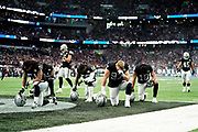 Oakland Raiders pray before kick off during the International Series match between Oakland Raiders and Chicago Bears at Tottenham Hotspur Stadium, London, United Kingdom on 6 October 2019.