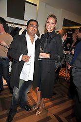 The HON.ANGAD PAUL and his wife MICHELLE at a party hosted by Petra Ecclestone at Matches, 87 Marylebone High Street, London on 7th September 2009.
