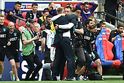 Aston Villa assistant manager John Terry  embraces Aston Villa manager Dean Smith as the final whistle is blown during the EFL Sky Bet Championship play off final match between Aston Villa and Derby County at Wembley Stadium, London, England on 27 May 2019.