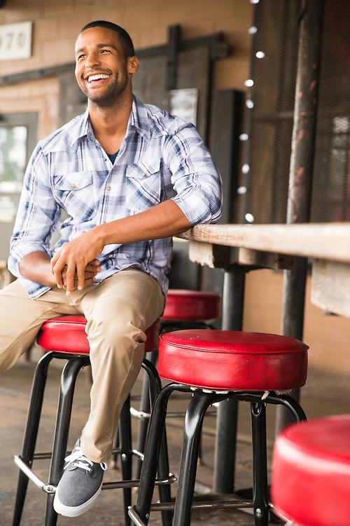 Wrangler plaid shirt fashion in Charelston, NC pool bar