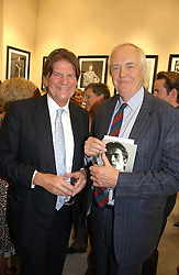 Left to right, JOHN MADEJSKI and SIR TIM RICE at an exhibition of photographs by Lord Snowdon held at the Chris Beetles Gallery, Ryder Street, London on 18th September 2006.<br />