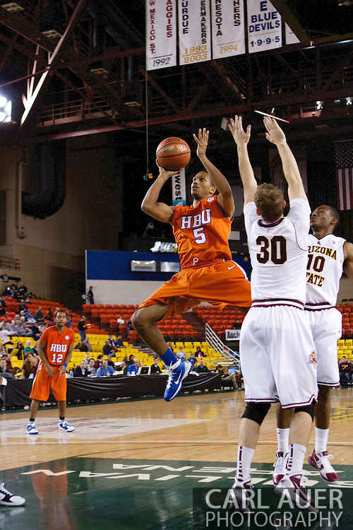 November 25th, 2010:  Anchorage, Alaska - Houston Baptist guard, Miles Dixon (5) attempts an off balance shot in the Huskies 55-73 loss to Arizona State in a first round game of the Great Alaska Shootout.