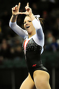 The University of Utah senior Jacquelyn Johnson flashes the Utes sign to the fans after her floor routine during the 2011 Women's NCAA Gymnastics Semifinals on April 15, in Cleveland, OH. The Utes advanced to tomorrow's super six round. (photo/Jason Miller)