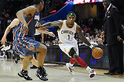 April 5, 2011; Cleveland, OH, USA; Cleveland Cavaliers point guard Daniel Gibson (1) drives past Charlotte Bobcats power forward Boris Diaw (32) during the fourth quarter at Quicken Loans Arena. The Cavaliers beat the Bobcats 99-89. Mandatory Credit: Jason Miller-US PRESSWIRE