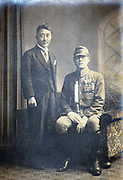 father with son in military uniform wearing medal decoration Japan 1930s