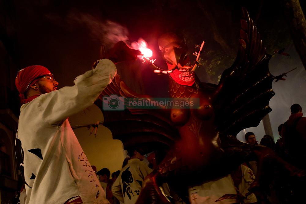 May 20, 2017 - Catalonia, Spain - In Barcelona a devil lights the pyrothecnics of a cardboard figure during a correfoc for the Festes de Maig (May Festival) at Poblenou neighbourhood. Correfocs, an old  tradition where people dressed as devils blow up firecrackers and flares, take part in many local festivals of the catalan country. (Credit Image: © Jordi Boixareu via ZUMA Wire)