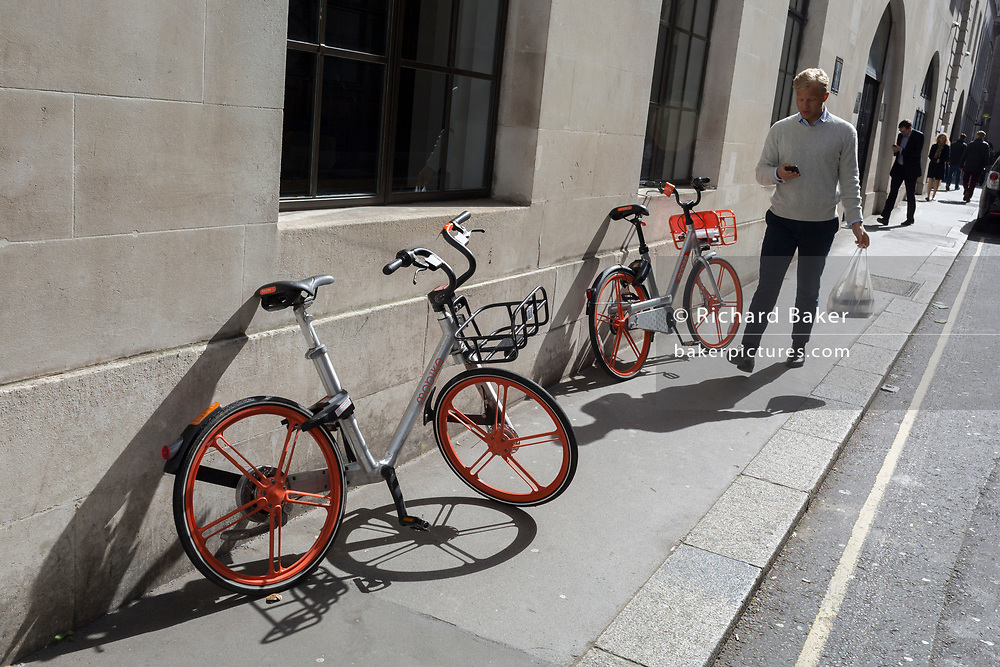 Discarded Mobikes in a side street of the City of London, the capital's financial district, on 25th March 2019, in London, England.