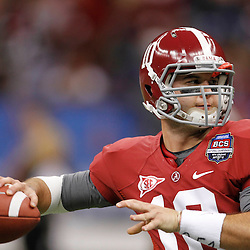 Jan 9, 2012; New Orleans, LA, USA; Alabama Crimson Tide quarterback A.J. McCarron (10) warms-up before the 2012 BCS National Championship game against the LSU Tigers  at the Mercedes-Benz Superdome. Mandatory Credit: Derick E. Hingle-US PRESSWIRE