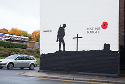 "© Licensed to London News Pictures. 21/10/2015.Tamworth, Staffordshire, UK. A remembrance mural that has just been painted on the outside of the ""Bulls Head"" Public House on the A5 at Two gates in Tamworth, Staffs. The mural has created a lot of interest from passing traffic and passers by. Photo credit : Dave Warren/LNP"