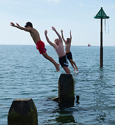 © Licenced to London News Pictures  - <br /> <br /> 23 June 2018  -  Aberystwyth Wales UK<br /> <br /> UK Weather:  Kids cool off by jumping and diving into the sea off the jetty on Aberystwyth beach  on yet another bright and sunny day, as the UK heads into a mini heatwave, with temperatures forecast to hit 29∫ or 30∫ Celsius by the middle of next week<br /> <br /> photo credit †Keith Morris / LNP