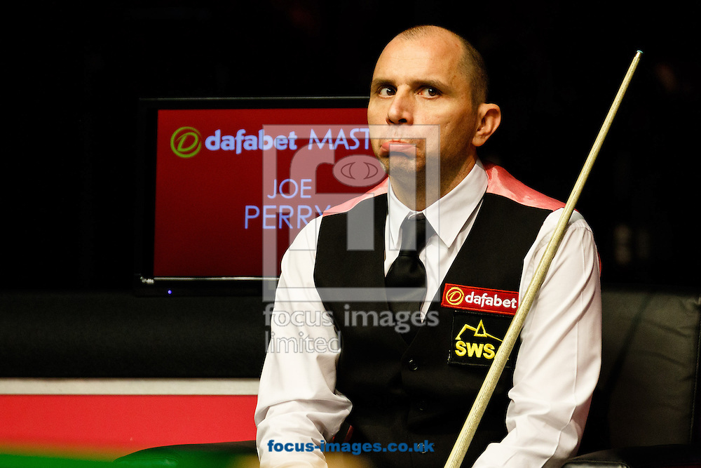 Joe Perry during the third quarter final of The Dafabet World Snooker Masters at Alexandra Palace, London<br /> <br /> Picture by Mark Chappell/Focus Images Ltd +44 77927 63340<br /> 16/01/2015