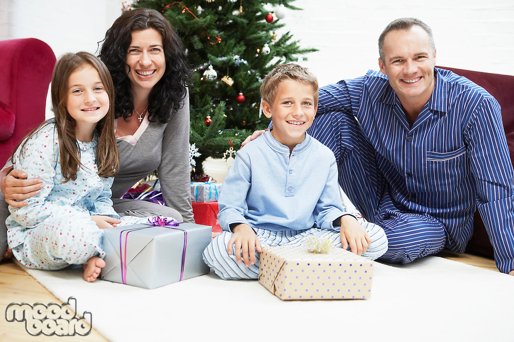 Happy Family in Front of Christmas Tree portrait
