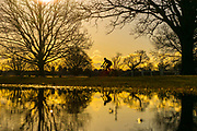 UNITED KINGDOM, London: 05 April 2018 A cyclist makes his way through Richmond Park as the sun rises this morning. After a miserable week of rain, the sun is set to shine throughout the day. Rick Findler / Story Picture Agency