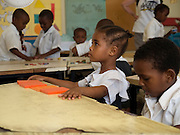 Nusery school children at Saateni nursery school in Zanzibar, Tanzania. VSO volunteer, Daphne Sharpe is working as a teacher trainer at the school. Daphne has now trained over 100 nusery school teachers and 18 heads of pre school.