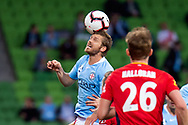 MELBOURNE, AUSTRALIA - APRIL 13: Melbourne City midfielder Luke Brattan (26) headers the ball during round 25 of the Hyundai A-League soccer match between Melbourne City FC and Adelaide United on April 13, 2019 at AAMI Park in Melbourne, Australia. (Photo by Speed Media/Icon Sportswire)