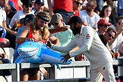 Adil Rashid of England signs a fancy dressed fans shark during day two of the fourth SpecSavers International Test Match 2018 match between England and India at the Ageas Bowl, Southampton, United Kingdom on 31 August 2018.