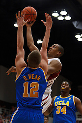 Dec 29, 2011; Stanford CA, USA;  Stanford Cardinal forward/center Josh Owens (13) shoots past UCLA Bruins forward David Wear (12) during the first half at Maples Pavilion.  Mandatory Credit: Jason O. Watson-US PRESSWIRE