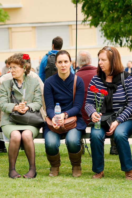 Women listening the speaches on May Day