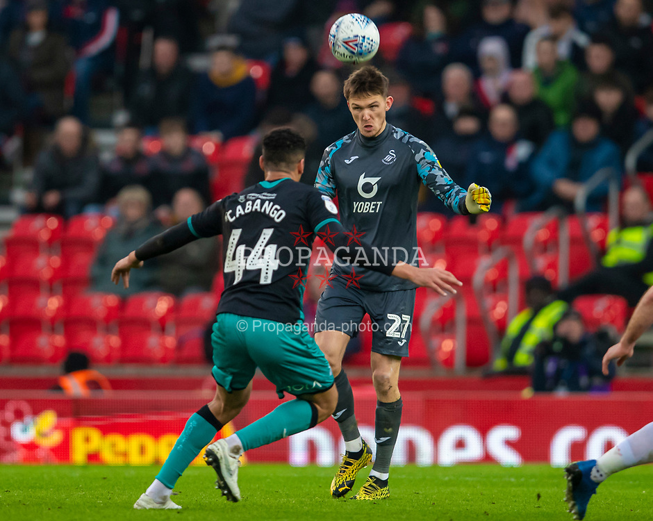 STOKE-ON-TRENT, ENGLAND - Saturday, January 25, 2020: Swansea City's goalkeeper Freddie Woodman heads the ball during the Football League Championship match between Stoke City FC and Swansea City FC at the Britannia Stadium. (Pic by David Rawcliffe/Propaganda)