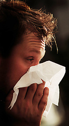 PICTURE POSED BY MODEL File photo dated 06/01/00 of a man blowing his nose. Sufferers could have relief from runny noses, sneezing and itchy eyes as scientists have developed the first ever hay fever map of Britain.
