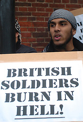 (c) London News Pictures. 09/11/2010. Members from 'Muslims Against Crusades' protest against British involvement in 'muslim lands' with posters and chants criticising the British Military. A counter-protest by the English Defence League (EDL) also took place across the road in Exhibition Road, London .Pictured - Protesters from the 'Muslims Against Crusades'