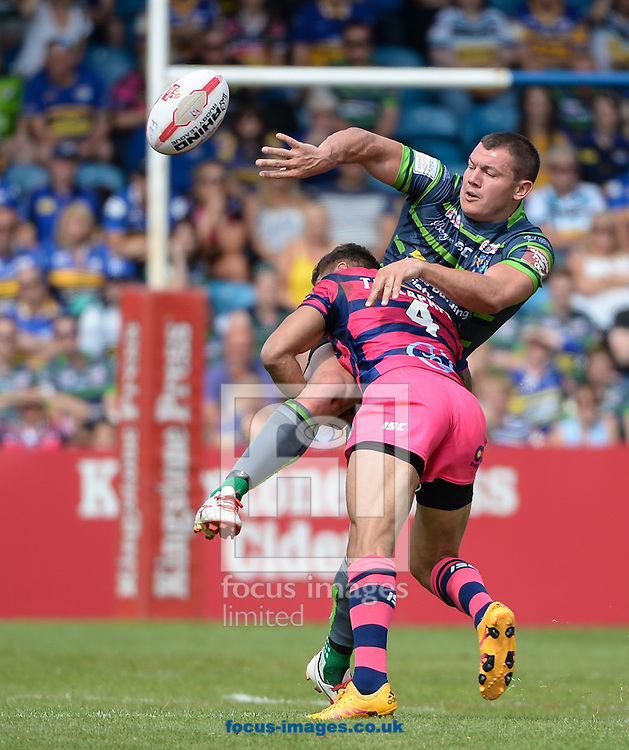 Brett Ferres of Leeds Rhinos offloads in the tackle during the Super 8s Qualifiers match at The Big Fellas Stadium, Post Office Road, Pontefract.<br /> Picture by Richard Land/Focus Images Ltd +44 7713 507003<br /> 06/08/2016
