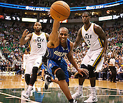 Magic guard Arron Afflalo (4) loses control of the basketball as Jazz players Mo Williams (5) and Marvin Williams (2) look on during the second half of the NBA basketball game between the Utah Jazz and the Orlando Magic at Energy Solutions Arena, Wednesday, Dec. 5, 2012.