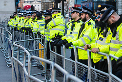 Police keep watch as protesters demonstrate on Whitehall in Long on against the visit to the UK by protest against Saudi Crown Prince Mohammad Bin Salman. London, March 07 2018.
