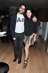 AMY MOLYNEAUX and LAURENT BENHAMOU at an after party following the first night of Dr Dee: An English Opera,  an opera created by theatre director Rufus Norris and musician and composer Damon Albarn held at St.Martin's Lane Hotel, St.Martin's Lane, London on 25th June 2012.