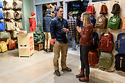 Guests mingle and look at clothing apparel and outdoor-outfitter gear during a grand opening event for Fjällräven Madison, a Swedish-heritage brand store in downtown Madison, Wis., on Oct. 22, 2015. Pictured talking is Steve Stout, Fjällräven Vice President of Retail, and Victoria Albrecht, assistant manager of the Fjällräven Madison Store. (Photo by Jeff Miller - www.jeffmillerphotography.com)