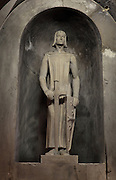 Statue of St Louis, or Louis IX of France, 1214-70, in the Chapelle des Cierges or Chapelle St Louis, in the Basilica of Liesse Notre Dame, built 1134 in Flamboyant Gothic style by the Chevaliers d'Eppes, then rebuilt in 1384 and enlarged in 1480 and again in the 19th century, Liesse-Notre-Dame, Laon, Picardy, France. Pilgrims flock here to worship the Black Virgin, based on Ismeria, the Soudanese daughter of the sultan of Cairo El-Afdhal, who saved the lives of French knights during the Crusades, converted to christianity and married Robert d'Eppes, son of Guillaume II of France. Picture by Manuel Cohen