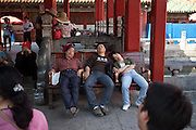 "Sleeping visitors inside  ""The Forbidden City"" which was the Chinese imperial palace from the Ming Dynasty to the end of the Qing Dynasty. It is located in the middle of Beijing, China. Beijing is the capital of the People's Republic of China and one of the most populous cities in the world with a population of 19,612,368 as of 2010."