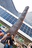 Boys sit in front this 7 meters high replica of the Ishango bone on the Munt Square in Brussels.The original carved bone, found by explorer Jean de Heinzelin de Braucourt in 1960 in the Belgian Congo, dates back 22.000 years, and is the first proof of mathematical knowledge of humans.
