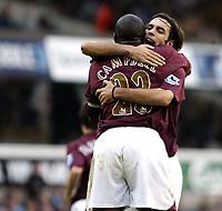 Photo: Chris Ratcliffe.<br />Tottenham Hotspur v Arsenal. The Barclays Premiership.<br />29/10/2005.<br />Robert Pires hugs Sol Campbell after scoring the equaliser