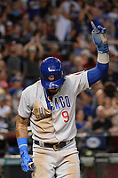 Aug 11, 2017; Phoenix, AZ, USA; Chicago Cubs infielder Javier Baez (9) points after scoring against the Arizona Diamondbacks in the eighth inning at Chase Field. Mandatory Credit: Jennifer Stewart-USA TODAY Sports