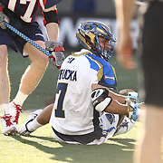 Jake Tripucka #7 of the Charlotte Hounds falls to the ground during the game at Harvard Stadium on May 17, 2014 in Boston, Massachuttes. (Photo by Elan Kawesch)